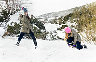 Friens having a snowball fight in the snow - MGOF03063