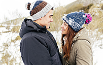 Couple in love standing in the snow - MGOF03066