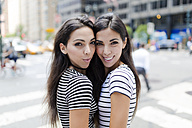 USA, New York City, portrait of two beautiful twin sisters in Manhattan - GIOF02188