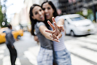 USA, New York City, two young women in Manhattan having fun - GIOF02191