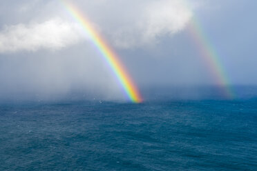 Portugal, Madeira, Rainbow over the Atlantic Ocean - RJF00658