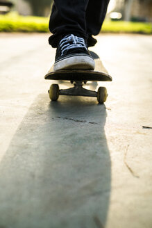 Feet of a skateboarder on a skateboard - KKAF00519