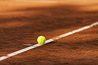 Tennis ball hitting the line on clay court - VABF01268