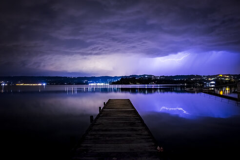 Italy, thunderstorm at a lake at night - SIPF01457