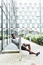 Irlenad, Dublin, young man exercising in the city - BOYF00690