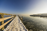 Germany, Bavaria, jetty at Chiemsee in winter - THAF01909