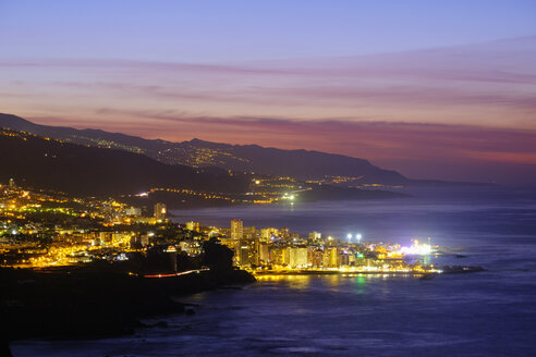 Spain, Canary Islands, Tenerife, Puerto de la Cruz at night - SIEF07339