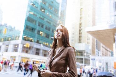 USA, New York, Manhattan,  portrait of young businesswoman with tablet - BOYF00716