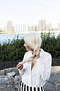 USA, Brooklyn, mature woman with hands in her hair - GIOF02281