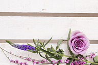 Floral arrangement with pink rose blossom on white wood - CMF00668