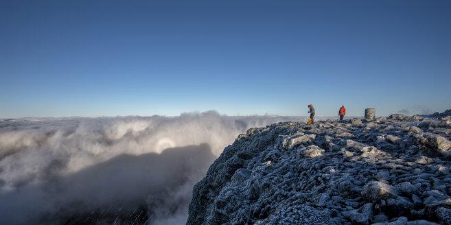 UK, Scotland, Ben Nevis, mountaineers on summit - ALRF00878
