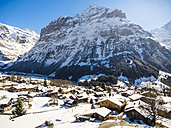 Switzerland, Canton of Bern, Grindelwald, townscape in winter at sunrise with Mittelhorn - AMF05345