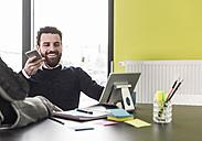 Businessman holding smart phone, talking - UUF10205