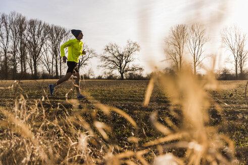 Man running in rural landscape - UUF10210