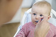 Baby girl being fed - FMKF03640