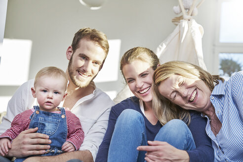 Portrait of happy familiy with baby girl at home - FMKF03652