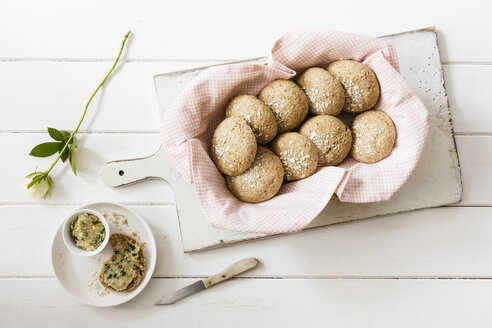 Homemade oat rolls with compound butter and a rose - EVGF03139