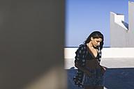 Young pretty woman wearing beach wear, looking pensive - GIOF02356