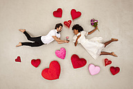 Young couple falling in love with hearts around - BAEF01261