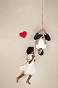 Couple falling in love, man hanging upside down - BAEF01267