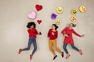 Female friends chatting and gossiping with emojies over their heads - BAEF01282