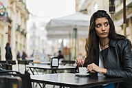 Young woman in a street cafe - KKAF00529