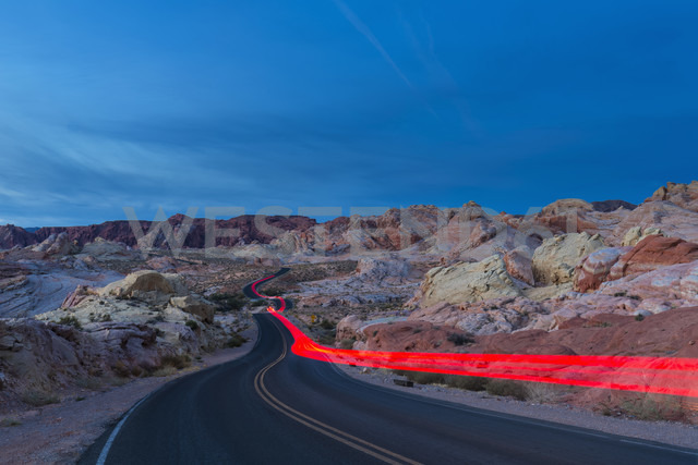 USA, Nevada, Valley of Fire State Park, sandstone and limestone rocks, light trails of a car on scenic road at twilight - FOF09088