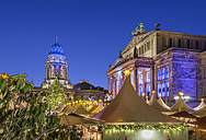 Germany, Berlin, Christmas market at Gendarmenmarkt at night - PVCF01046