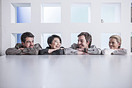Four smiling colleagues in office - ZEF13192