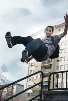 Young man doing Parkour in the city - SKCF00278