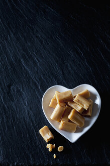 Cream toffees on a heart-shaped plate - CSF28130