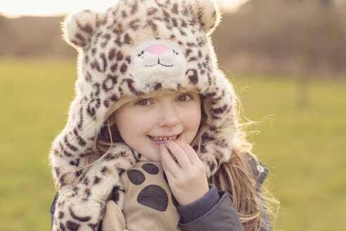Portrait of shy little girl wearing hat with leopard print - NMSF00026