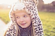 Portrait of shy little girl wearing hat with leopard print - NMSF00029