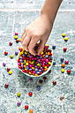 Girl's hand taking chocolate button - SARF03266