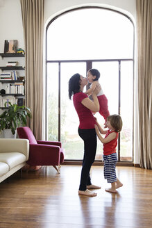 Mom playing with her children in the living room - LITF00565