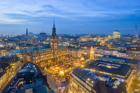 Germany, Hamburg, Christmas market at city hall in the evening - RJF00687