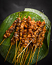 Chicken satay skewers and banana leaf - KSWF01787