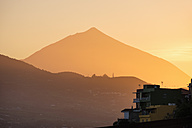 Spain, Tenerife, Las Canteras near San Cristobal de La Laguna, Pico del Teide in haze at sunset - SIEF07365