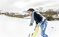 Young man having fun with a sled in the snow - MGOF03135
