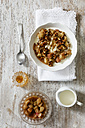 Bowl of porridge with rhubarb compote, honey and nuts - EVGF03156