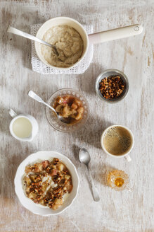 Breakfast with bowl of porridge with rhubarb compote, honey and nuts and cup of coffee - EVGF03159