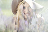 Portrait of smiling young woman in lavender field - ZEF13232