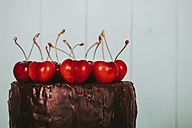 Cherries on cake with chocolate icing, close-up - RTBF00785