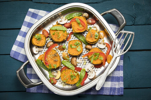 Raw vegetables and herbs in a pan - MAEF12181
