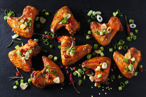 Marinated and grilled chicken wings on slate - CSF28204