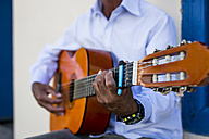 Cuba, man playing guitar, partial view - MAUF01021