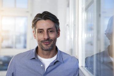 Portrait of smiling man in office - FKF02227