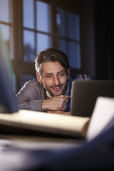 Man working late in office - FKF02233
