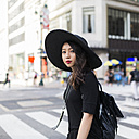 USA, New York City, Manhattan, portrait of fashionable young woman dressed in black - GIOF02479