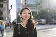 USA, New York City, Manhattan, portrait of smiling young woman - GIOF02482